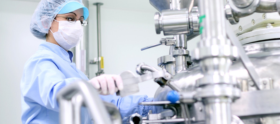 Preparing machine for work in pharmaceutical factory. Selective Focus. Shallow depth of field.